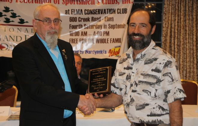 Jack Boquin of the West Falls Conservation Club, right, accepts the Stan Spisiak Conservation Award for the Region 9 Youth Archery Camp from Frank Miskey Sr. (Bill Hilts, Jr./Buffalo News)