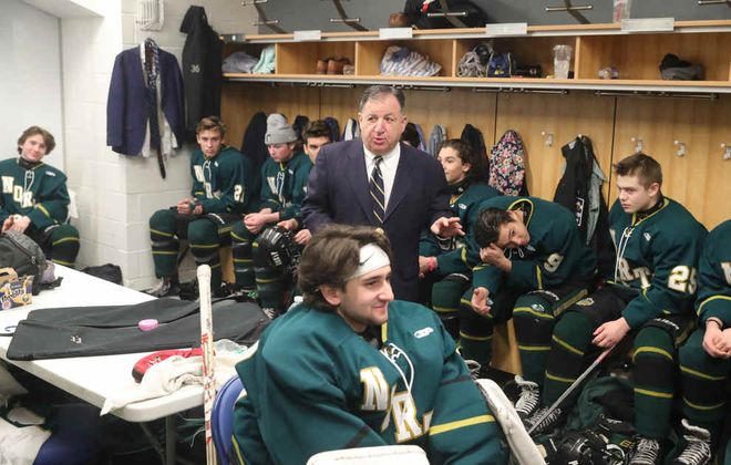 Williamsville North coach Bob Rosen talks to the team in the locker room Sunday. North won the Section VI Division I championship and secured Rosen's 500th career win in the process at KeyBank Center (John Hickey/Buffalo News)
