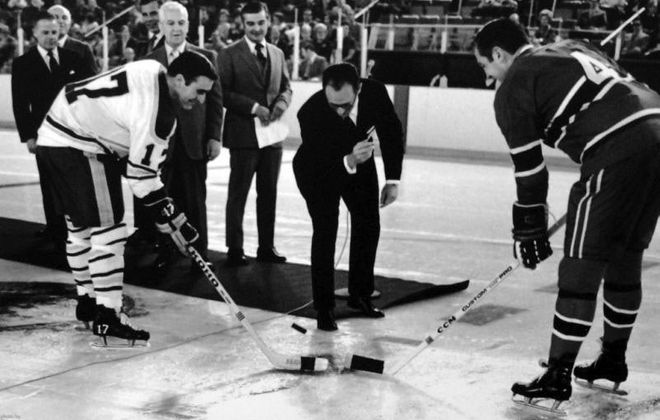 Sabres owner Seymour H. Knox III drops the ceremonial first puck for the first NHL game at Buffalo's Memorial Auditorium. Captain Floyd Smith, Sabres and Jean Beliveau, Montreal Canadiens in October 1970. (News file photo)