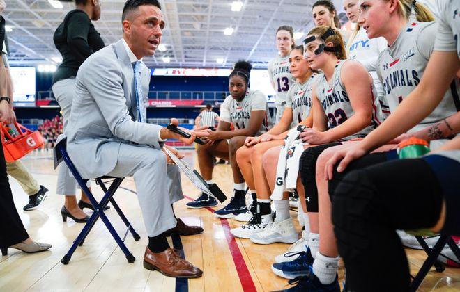Robert Morris women's basketball coach Charlie Buscaglia talks to his players during a game against Sacred Heart. (Jason Cohn/Robert Morris University)