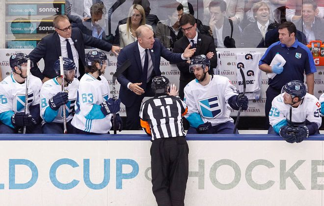 Current Sabres coach Ralph Krueger discusses a penalty call with referee Kelly Sutherland at the Team Europe bench during the 2016 World Cup of Hockey final in Toronto as assistant and current Winnipeg coach Paul Maurice, left, looks on (Getty Images).