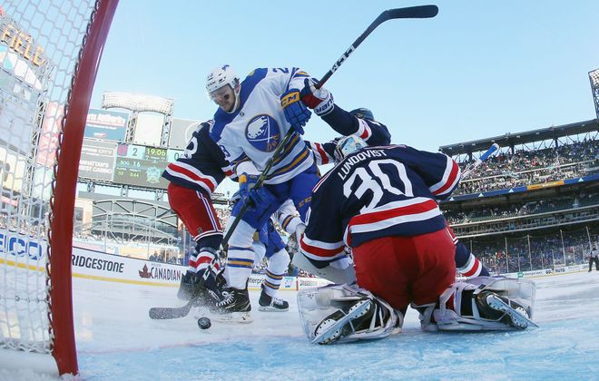 Sam Reinhart beats Rangers goalie Henrik Lundqvist for the Sabres' first goal in the NHL Winter Classic at Citi Field on Jan. 1, 2018 (Getty Images).