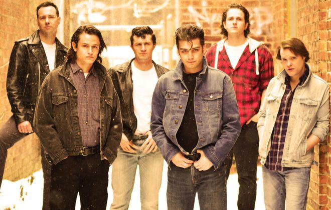 """The cast of """"The Outsiders"""" on stage at the Theatre of Youth. (Photo by Michael Walline)"""