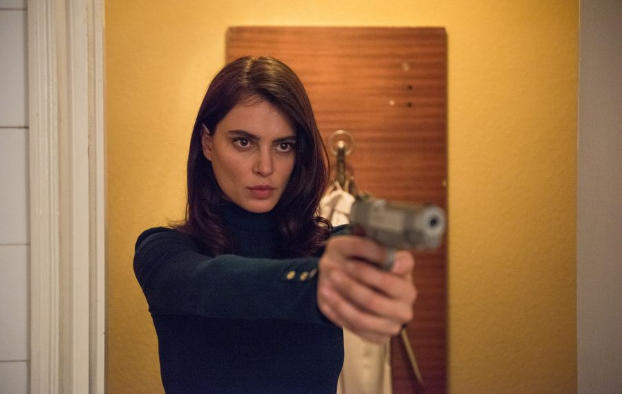 """Catrinel Marlon stars in the crime thriller """"The Whistlers,"""" one of the films you can watch at home as part of virtual cinema programs.  (Vlad Cioplea/courtesy of Magnolia Pictures)"""