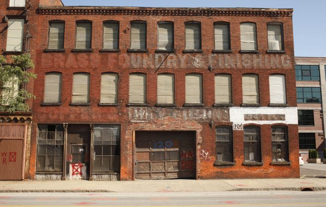 The city wants the owner of two 19th-century brick buildings in the Cobblestone District, including this one pictured in 2010, to address the buildings' conditions. (Derek Gee/News file photo