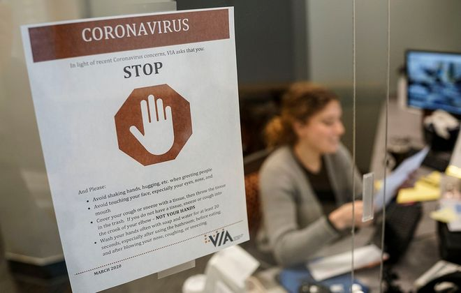 A sign at the front desk of the Olmsted Center for Sight in Buffalo advises visitors to take precautions to prevent the spread of COVID-19 coronavirus, Monday, March 16, 2020. (Derek Gee/Buffalo News)