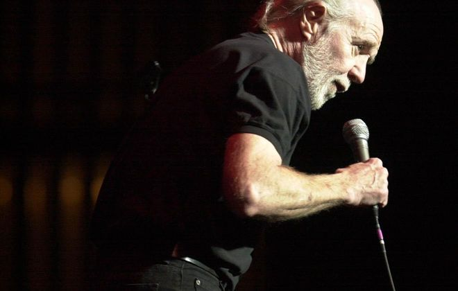 The late comedian George Carlin, here playing Shea's Performing Arts Center in 2001, once riffed on whites trying to talk like blacks. But this time they've gone too far, Rod Watson says. (Mark Mulville/News file photo)