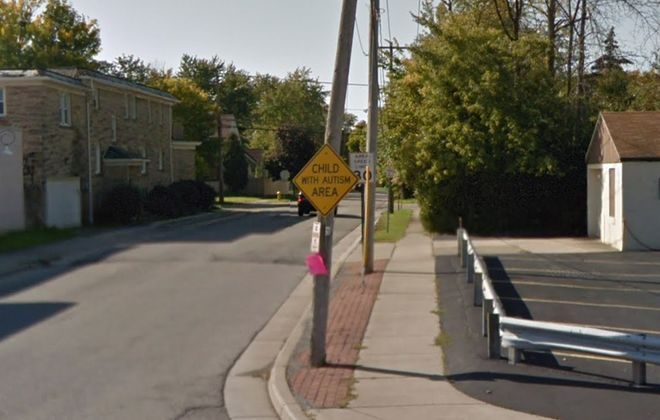"A ""Child with Autism Area"" sign at Bailey Avenue and Cambridge Boulevard in Amherst. (Google)"
