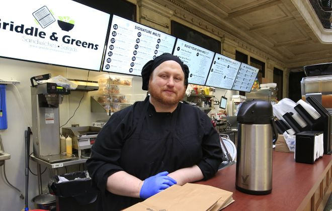 Cook Cody Wilcox flying solo behind the counter at Griddle & Greens. (Harry Scull Jr./Buffalo News)