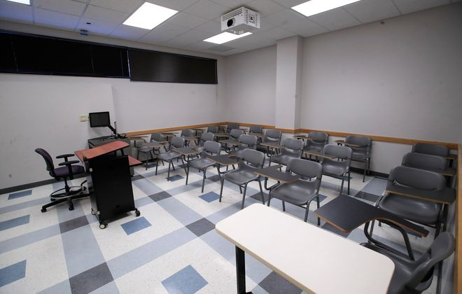 An empty classroom on the University at Buffalo Amherst Campus, on Friday, March 13, 2020. (Harry Scull Jr./Buffalo News)