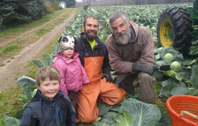 Daniel Oles, far right, and his family. (Photo courtesy of the Promised Land CSA)