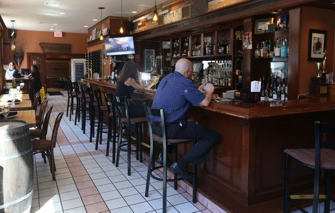 """""""People need to eat, people need to drink,"""" said Nick Pitillo, owner of Osteria 166. """"That's what we do for a living. Maybe the delivery method will be different, but we'll figure it out."""" (Sharon Cantillon/Buffalo News)"""