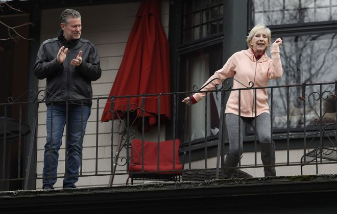 Doug Smith and Nadja Piatk dance on their second-floor balcony, overlooking their Lexington Avenue neighborhood. (Sharon Cantillon/News file photo)