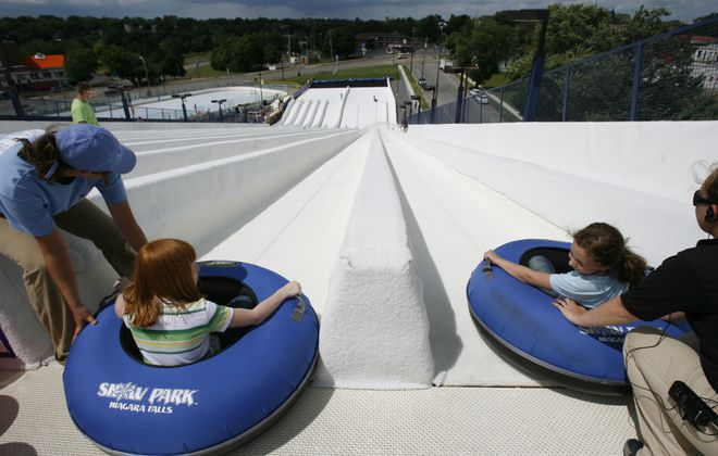 In this June 30, 2009, photo, two kids get ready to go tubing at Snow Park Niagara Falls, which is to be demolished this year. (Sharon Cantillon/Buffalo News)