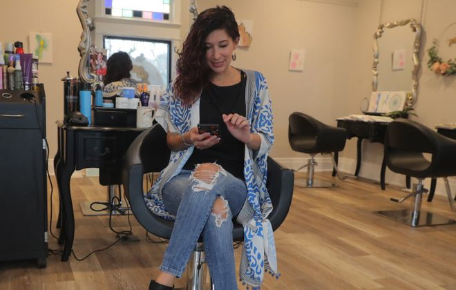 """""""We ended up closing shop. Too close contact with people, some cancellations,"""" said Charlene Minx, hairstylist and owner of Salon de Coquette on Connecticut Street. (John Hickey/Buffalo News)"""