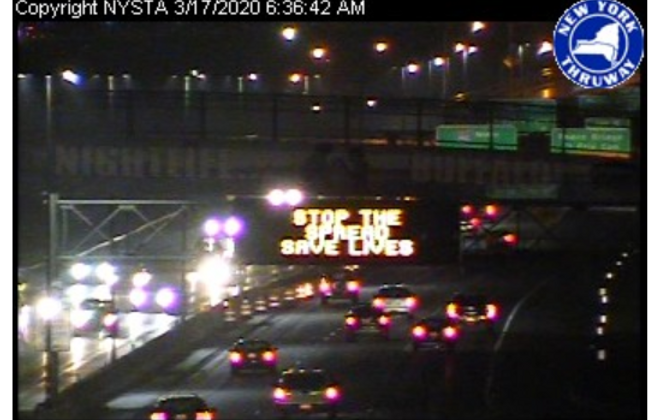 A Thruway traffic camera of the I-90 Northbound shows the electronic signs advising motorists regarding the coronavirus epidemic. (via screenshot of Thruway traffic camera)