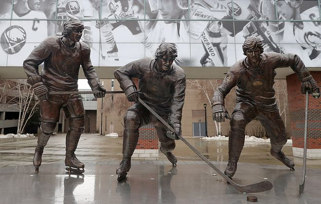 The French Connection statue honors the greatest line in Buffalo Sabres history. Located outside of KeyBank Center, it is based on a photo by former Buffalo News Photographer Ron Moscati. (John Hickey/Buffalo News)