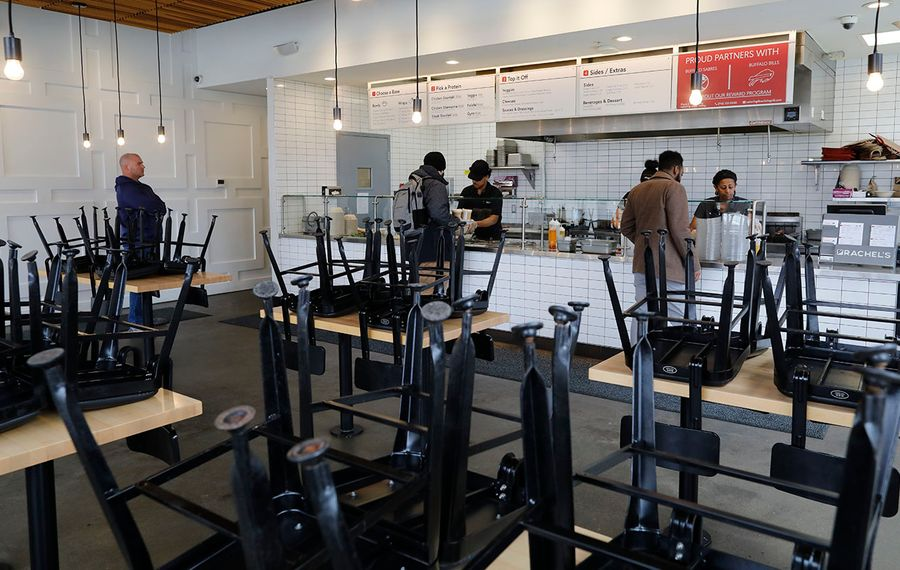 Chairs are stacked up on the tables to prevent customers from sitting down at Rachel's Mediterranean on Elmwood and Chippewa, where customers were keeping a distance from one another while placing their orders on March 18. (Derek Gee/Buffalo News)