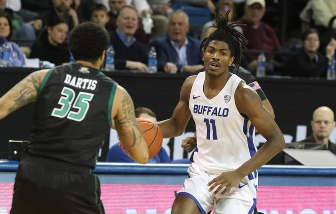 Buffalo Bulls forward Jeenathan Williams (11) dribbles the ball up the court against Ohio Bobcats guard Jordan Dartis (35) in the first half at University at Buffalo's Alumni Arena in Amherst, on Tuesday, Jan. 14, 2020.  (James P. McCoy/Buffalo News)