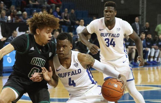 Buffalo Bulls guard Davonta Jordan (4) scores two points over Buffalo Bulls guard David Nickelberry (0) in the first half at University of Buffalo Alumni Arena on Tuesday, Jan. 14, 2020.  (James P. McCoy/Buffalo News)
