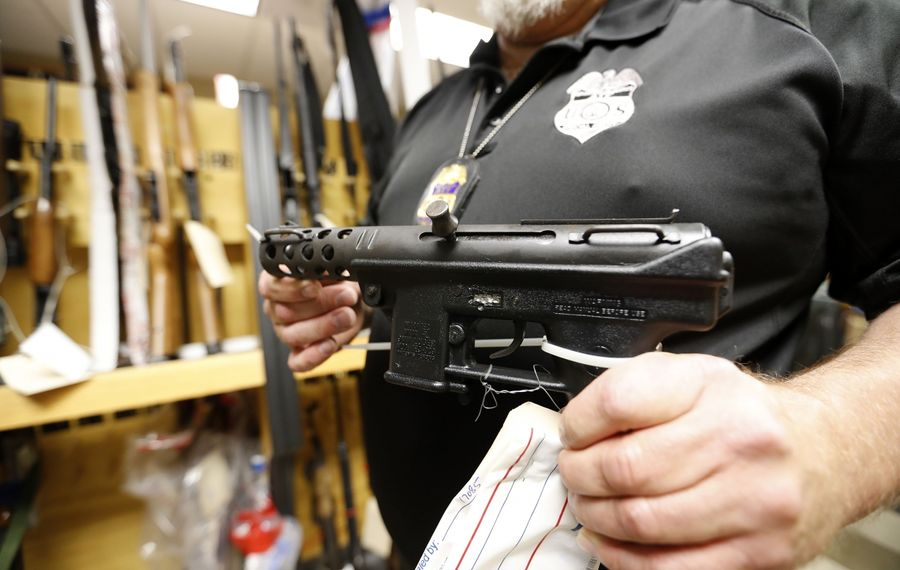 Banning charity gun raffles won't stop criminals from getting guns like this one that Buffalo's office of the Bureau of Alcohol, Tobacco, Firearms and Explosives took off the streets. (Mark Mulville/News file photo)