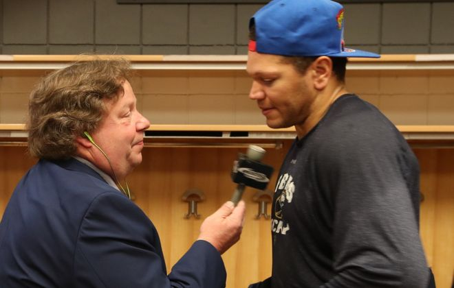 Paul Hamilton, of WGR-550 interviews Buffalo Sabres right wing Kyle Okposo (21) in 2017. (James P. McCoy/News file photo)
