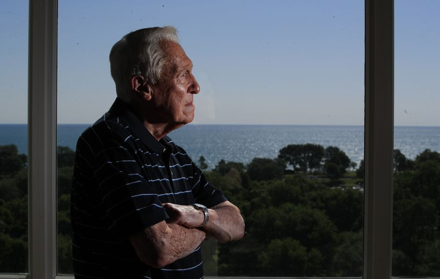 From his Chicago home overlooking Lake Michigan, former Buffalo Bills coach and World War II veteran Marv Levy is pushing the NFL to honor the 75th anniversary of the war and its 'greatest generation' this year. (Harry Scull Jr./Buffalo News)