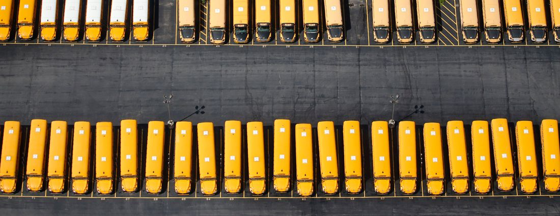 Under a proposed new contract, First Student promises more info for Buffalo parents when weather or other factors causes school buses to run late or be rerouted. Here, a   First Student bus garage in Tonawanda as viewed by drone. (Derek Gee/News file photo)