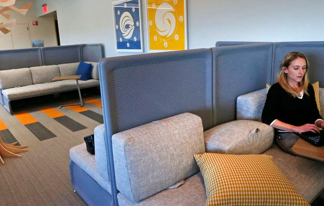 Senior programming analyst Meghan Downey catches up on a report in a new quiet relaxation room at Rich Products' corporate office building in Buffalo in October. (Robert Kirkham/News file photo)