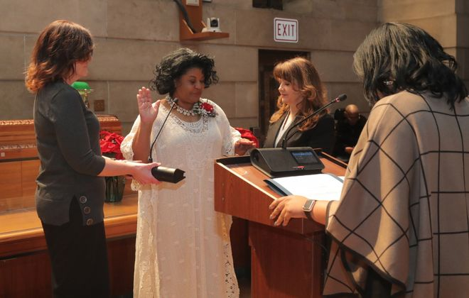 Buffalo Comptroller Barbara Miller-Williams takes the oath of office Thursday in the Common Council chambers in City Hall. Council members also were sworn in during a separate ceremony. (John Hickey/Buffalo News)