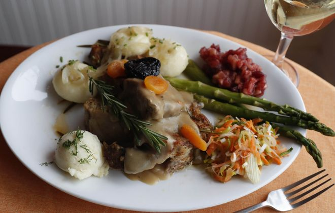 Euro Café's Polish style country ribs are served with four salads and potato dumplings. (Sharon Cantillon/Buffalo News)