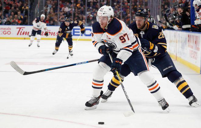 Edmonton Oilers captain Connor McDavid (97) advances the puck in the second period as Buffalo Sabres forward Zemgus Girgensons (28) defends. (Sharon Cantillon/Buffalo News).