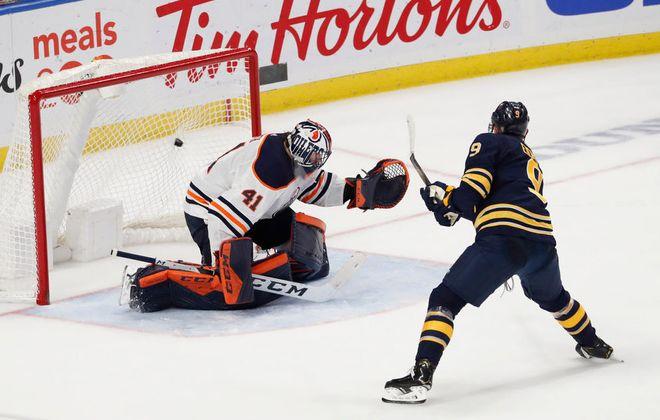 Buffalo Sabres captain Jack Eichel (9) scores on a penalty shot on Edmonton Oilers goalie Mike Smith in overtime to give the Sabres a 3-2 victory over the Edmonton Oilers at KeyBank Center, Thursday, Jan. 2, 2020. (Sharon Cantillon/Buffalo News)