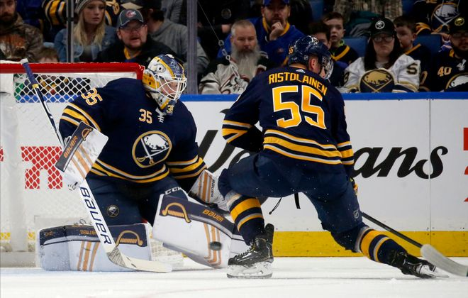 Buffalo Sabres goalie Linus Ullmark makes a save in front of defenseman Rasmus Ristolainen as the Sabres faced the Florida Panthers at Keybank Center on Saturday, Jan. 4, 2020. (Robert Kirkham/Buffalo News)