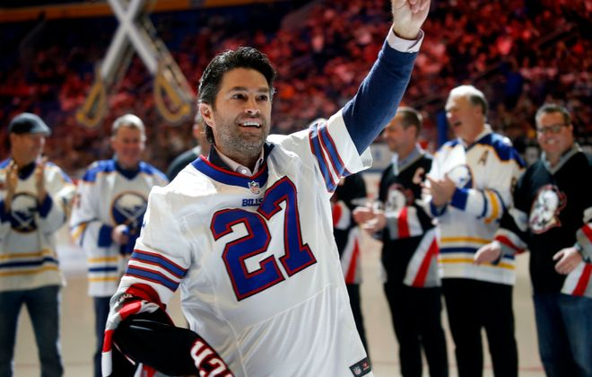 Former captain Michael  Peca took off his Sabres jersey to show a Bills' Tre'Davious White jersey as he was introduced Saturday in KeyBank Center (Robert Kirkham/Buffalo News).
