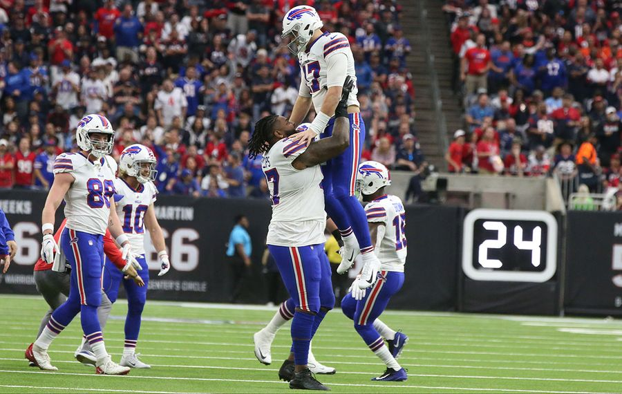 Bills quarterback Josh Allen celebrates after diving into the end zone over Texans strong safety Jahleel Addae for a touchdown. (James P. McCoy/Buffalo News)