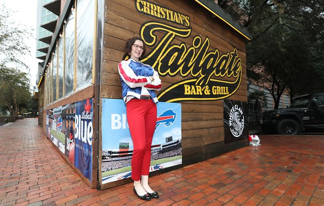 Katie O'Brien, pictured outside the Houston Bills Backers bar Christian's Tailgate in Houston; by tonight, that entire area will be packed with Bills fans. (James P. McCoy/Buffalo News)