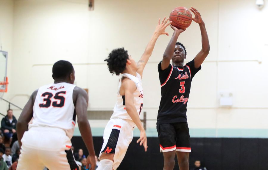 Middle Early College player Keith Brown shoots against McKinley during first half action at McKinley High School, Tuesday, Jan. 7, 2020. (Harry Scull Jr./Buffalo News)