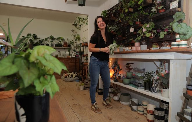 Rachel Stepien wears a casual, practical outfit with fun accessories at the Plant Shack in East Aurora. (John Hickey/Buffalo News)