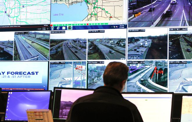 Technician John Thompson monitors the live feeds from dozens of traffic cameras on major roads in Western New York and Southern Ontario at NITTEC Traffic Operations headquarters in downtown Buffalo on Jan. 7, 2020. (Derek Gee/Buffalo News)