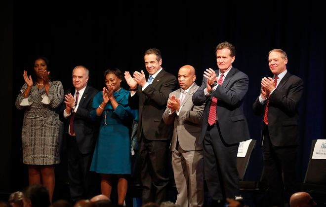 Democratic and Republican leaders of both legislative chambers, shown among others with Gov. Andrew M. Cuomo in January, should be involved in all budget decisions. (Mark Mulville/Buffalo News)