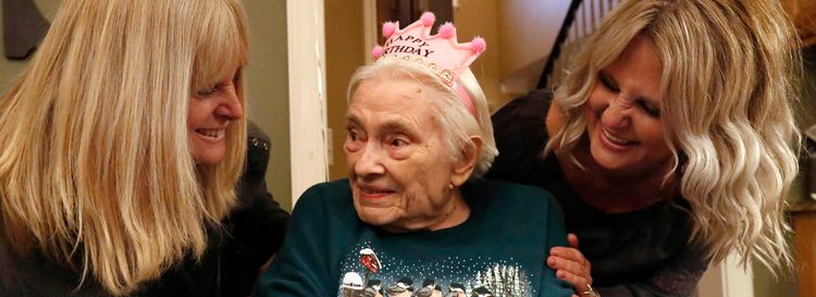 Mary Ellen Sharp with her daughter, Tarynn Willson, left, and granddaughter Krysten Schmidt as she celebrates her 90th birthday at Schmidt's house in Batavia on Jan. 11. (Sharon Cantillon/Buffalo News)