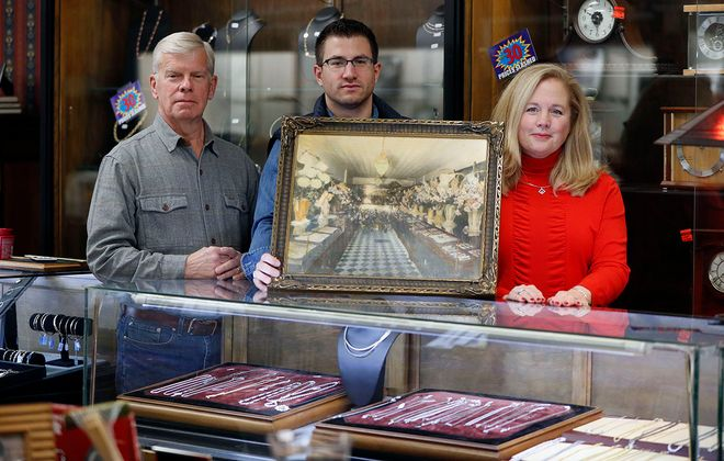 Pepper Hofert, left, Andrew Hofert, center, and Susan Hofert, right, in Hofert Jewelers on Delaware Avenue in Kenmore.  After 90 years in business, Hofert Jewelers is closing this month. (Mark Mulville/Buffalo News)