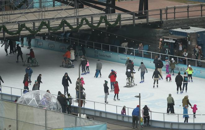 Ice skaters enjoy the ice rink at Canalside in Buffalo. (James P. McCoy/Buffalo News)
