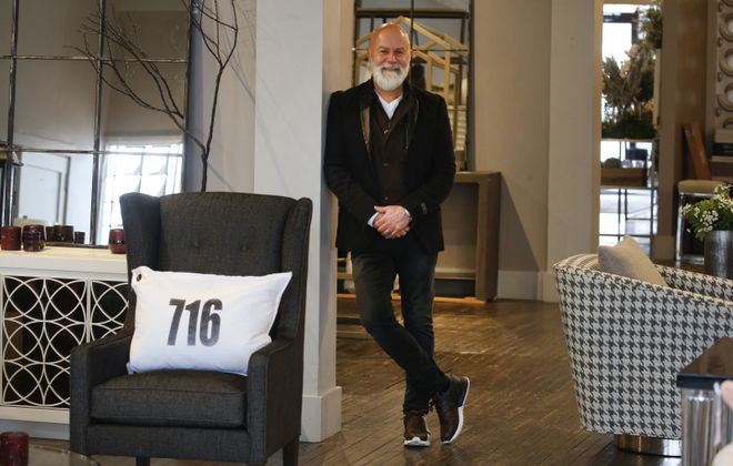 Michael Poczkalski, co-owner and principal designer of room, a home store at 1400 Hertel Ave., and  Michael P. Design. (Robert Kirkham/Buffalo News)