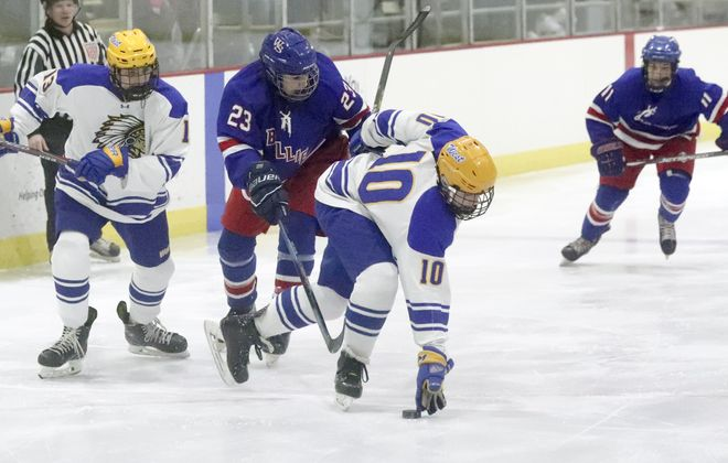 Williamsville South's Christian Williams (23) battles West Seneca West's Brian Gorman (10) for the puck in the first period at West Seneca Ice Rink in West Seneca, NY on Friday, Jan. 17.  James P. McCoy/Buffalo News
