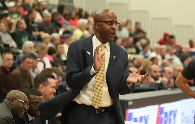 Canisius Golden Griffins head coach Reggie Witherspoon cheers on his team in the first half at Koessler Center in Buffalo, NY on Friday, Jan. 17, 2020.  James P. McCoy/Buffalo News