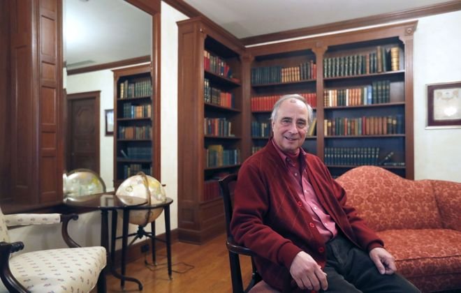 Francis Kowsky, SUNY Buffalo State distinguished professor emeritus of fine arts, sits in the library from the Metcalfe House preserved in Rockwell Hall. Kowsky was instrumental in getting Buffalo State to take the Metcalfe House's dining and living rooms prior to the house's demolition. (Mark Mulville/Buffalo News)