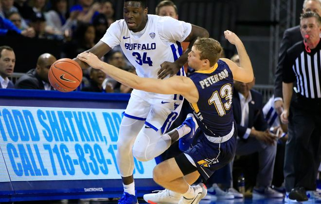 University at Buffalo player Josh Mballa is fouled by Kent State player Mitch Peterson during the first half at Alumni Arena, Friday, Jan. 24, 2020. (Harry Scull Jr./Buffalo News)