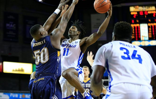 University at Buffalo player Jeenathan Williams is defended by Kent State's Kalin Bennett during the first half at Alumni Arena, Friday, Jan. 24, 2020. (Harry Scull Jr./Buffalo News)